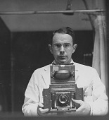 view [Photographer holding large folding camera : photoprint.] digital asset: Harvey Cushing Photographs, taken by Walter Boyd, Peter Bent Brigham Hospital 30th Anniversary Photographic Exhibit, Copied- May, 1963. Pictures: 81-139. Index Included.