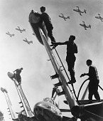 view [Airmen fueling military airplanes : black-and-white photoprint] digital asset: Refueling wing-Tip tanks on fighter planes, undated