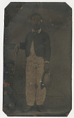 view Photo (tintype) of unidentified boy (holding a hat next to a chair). digital asset: Photo (tintype) of unidentified boy (holding a hat next to a chair).