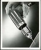 view Women Operating Heavy Machinery, Woman holding a pneumatic drill digital asset: Women Operating Heavy Machinery, Woman holding a pneumatic drill