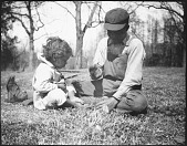 view Two Chickahominy Children Cracking Walnuts digital asset: Two Chickahominy Children Cracking Walnuts