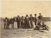 view Lakota (Teton/Western Sioux) men and non-Indians at Fort Laramie for the 1868 treaty signing digital asset: [P15386] Lakota (Teton/Western Sioux) men and non-Indians  gathered at Fort Laramie for the 1868 treaty signing. From left to right they are: unidentified non-Indian man, Leon Pallardy (interperter), unidentified Native woman, Running Water (Lakota), two unidentified non-Indian men, John D. Howland, (seated) Ashton S. H. White, and unidentified non-Indian man