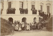 view American Indian delegates at White House in Washington, D.C. digital asset: [P10142] American Indian delegates posing with President Andrew Johnson (1808-1875; standing center balcony, third from left) outside the White House in Washington, D.C. Delegates include individuals from the Ihanktonwan Nakota (Yankton Sioux), Dakota (Eastern Sioux), Santee, Upper Missouri Sioux, Sac and Fox (Sauk & Fox), Anishinaabe (Chippewa/Ojibwa), Ottawa, Kickapoo, and Miami tribes.  Also included in the photo are Commissioner Lewis Bogy (center balcony, second from left), and Secretary of the Interior Orville H. Browning (center balcony, fourth from left), and Father Pierre-Jean De Smet (right balcony, second from left)