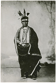 view Portrait photograph of an unidentified Native American man, possibly Apsáalooke (Crow/Absaroke) digital asset: Portrait photograph of an unidentified Native American man, possibly Apsáalooke (Crow/Absaroke)