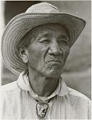 view Abigail Adler Diné (Navajo) photographs digital asset: Portrait of Medicine Man, Sonny Claus Chee [Diné (Navajo)]