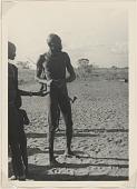view Man holding pipe, Uganda digital asset: Man holding pipe, Uganda