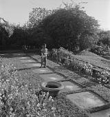 view Boy in Garden, Natal, South Africa digital asset: Boy in Garden, Natal, South Africa