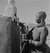 view Ndebele Woman Painting Gatepost digital asset: Ndebele Woman Painting Gatepost