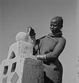 view Ndebele Woman Painting Gatepost digital asset: Ndebele Woman Painting Gatepost