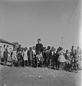 view Father Huddleston With Children, Sophiatown, Johannesburg digital asset: Father Huddleston With Children, Sophiatown, Johannesburg