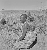 view Young Swazi boy with baby, Nhlangano (Swaziland) digital asset: Young Swazi boy with baby, Nhlangano (Swaziland)