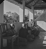 view Lovedu men seated on a porch, Northern Transvaal (South Africa) digital asset: Lovedu men seated on a porch, Northern Transvaal (South Africa)
