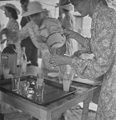 view Afrikaner woman pouring beverages after Nagmaal (Holy Communion), Bronkhorstspruit (South Africa) digital asset: Afrikaner woman pouring beverages after Nagmaal (Holy Communion), Bronkhorstspruit (South Africa)