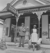 view Henry Vollam Morton (H. V. Morton) outside Martin Chemist store, Somerset West (South Africa) digital asset: Henry Vollam Morton (H. V. Morton) outside Martin Chemist store, Somerset West (South Africa)