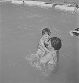 view Woman swimming with children, Hazyview (South Africa) digital asset: Woman swimming with children, Hazyview (South Africa)