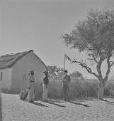 view Officers in San village, Kalahari Desert, Botswana digital asset: Officers in San village, Kalahari Desert, Botswana