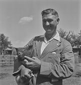 view W.L.J. Van Rensburg with pig, Transkei (South Africa) digital asset: W.L.J. Van Rensburg with pig, Transkei (South Africa)