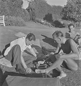 view Noel Coward and Norman Hackforth playing backgammon, Pretoria (South Africa) digital asset: Noel Coward and Norman Hackforth playing backgammon, Pretoria (South Africa)