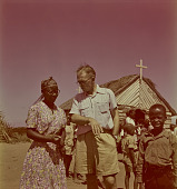 view Alan Paton with Zulu woman and children in front of church, KwaZulu-Natal (South Africa) digital asset: Alan Paton with Zulu woman and children in front of church, KwaZulu-Natal (South Africa)
