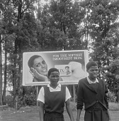 view Young girls in front of sign, Ixopo (South Africa) digital asset: Young girls in front of sign, Ixopo (South Africa)