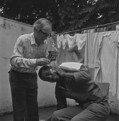 view Man getting his ear cleaned, Soweto (South Africa) (Johannesburg (South Africa)) digital asset: Man getting his ear cleaned, Soweto (South Africa) (Johannesburg (South Africa))