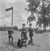 view Children in uniform waiting by street sign, Soweto (South Africa) digital asset: Children in uniform waiting by street sign, Soweto (South Africa)