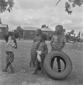 view Children playing with tires, Soweto (South Africa) digital asset: Children playing with tires, Soweto (South Africa)