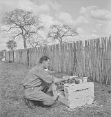 view Man preparing beverages in Kruger National Park, South Africa digital asset: Man preparing beverages in Kruger National Park, South Africa