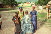 view The Imam of Bafodea town and his daughters, Bafodea Town, Sierra Leone digital asset: The Imam of Bafodea town and his daughters, Bafodea Town, Sierra Leone