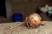 view Gourd with string and beads, called husaka, played only by women, Bafodea Town, Sierra Leone digital asset: Gourd with string and beads, called husaka, played only by women, Bafodea Town, Sierra Leone