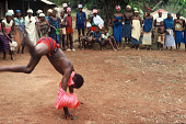 view Boy performing acrobatic dance for his initiation rite, gbondokali, Kadankan village, Sierra Leone digital asset: Boy performing acrobatic dance for his initiation rite, gbondokali, Kadankan village, Sierra Leone