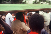 view Arrival of Honorable P.H. Kamara, a minister in the Sierra Leone government,carried in a hammock, Bafodea Town, Sierra Leone digital asset: Arrival of Honorable P.H. Kamara, a minister in the Sierra Leone government,carried in a hammock, Bafodea Town, Sierra Leone