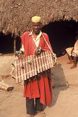 view Mandingo musician with his balaphon at memorial for a non-Muslim Limba village head, Kadanso Village, Sierra Leone digital asset: Mandingo musician with his balaphon at memorial for a non-Muslim Limba village head, Kadanso Village, Sierra Leone