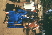 view Lansana Bangura, wearing hunter hat, and Mohamed Bangura, a woodcarver, Bafodea Town, Sierra Leone digital asset: Lansana Bangura, wearing hunter hat, and Mohamed Bangura, a woodcarver, Bafodea Town, Sierra Leone