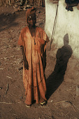 view At the end of his bush period, initiated boy wearing his brown native cloth and native cloth cap. Sirekude Village, Sierra Leone digital asset: At the end of his bush period, initiated boy wearing his brown native cloth and native cloth cap. Sirekude Village, Sierra Leone