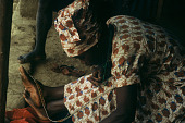 view Siridi Conteh, using her foot, makes a beaded band, Siemamaya Village, Sierra Leone digital asset: Siridi Conteh, using her foot, makes a beaded band, Siemamaya Village, Sierra Leone