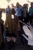 view Man wearing hu ronko shirt, next to the weaver Momodu Conde, Kamanda Village, Sierra Leone digital asset: Man wearing hu ronko shirt, next to the weaver Momodu Conde, Kamanda Village, Sierra Leone