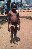 view Boy wearing undyed native waistpiece, Kamanda Village, Sierra Leone digital asset: Boy wearing undyed native waistpiece, Kamanda Village, Sierra Leone