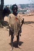 view Boy wearing undyed native shirt, Kamanda Village, Sierra Leone digital asset: Boy wearing undyed native shirt, Kamanda Village, Sierra Leone