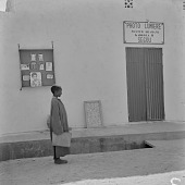 view A boy standing in front of a photo studio in Ségou, Mali digital asset: A boy standing in front of a photo studio in Ségou, Mali