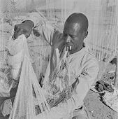 view Fishman repairing a fishing net on the Senegal River, Mali digital asset: Fishman repairing a fishing net on the Senegal River, Mali
