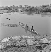 view Boys sitting in a dugout canoe on the shore of the Senegal River, Mali digital asset: Boys sitting in a dugout canoe on the shore of the Senegal River, Mali