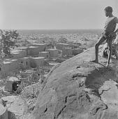 view Bobo boy looking at Kori Kori village, Mali digital asset: Bobo boy looking at Kori Kori village, Mali
