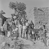 view Tour group with Bobo people in Kori Kori village, Mali digital asset: Tour group with Bobo people in Kori Kori village, Mali