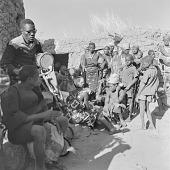 view Bobo men and women playing instruments and singing in Kori Kori village, Mali digital asset: Bobo men and women playing instruments and singing in Kori Kori village, Mali