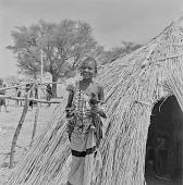 view Peul (Fula) woman outside of her tent at an encampment near Mopti, Mali digital asset: Peul (Fula) woman outside of her tent at an encampment near Mopti, Mali