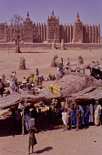 view People shopping at a market outside of the Great Mosque of Djenné, Djenné, Mali digital asset: People shopping at a market outside of the Great Mosque of Djenné, Djenné, Mali
