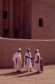 view Three men talking in front of the Great Mosque of Djenné, Djenné, Mali digital asset: Three men talking in front of the Great Mosque of Djenné, Djenné, Mali