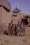 view Dogon children standing outside of a granary in a village between Douentza and Hombori, Mali digital asset: Dogon children standing outside of a granary in a village between Douentza and Hombori, Mali
