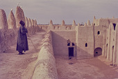 view A Muezzin standing on the gallery of the Grand Mosque of San, San, Mali digital asset: A Muezzin standing on the gallery of the Grand Mosque of San, San, Mali